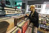 Teenager browsing in a record shop, Leamington Spa, Warwickshire - John Harris - 15-02-2018