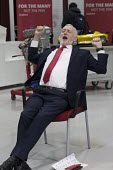 Jeremy Corbyn stretching and yawning in good humour, Robert Peston interview, Labour Party Jobs First Brexit speech, Coventry University Technology Park - John Harris - 2010s,2018,Brexit,Coventry,EU,European Union,eurosceptic,Euroscepticism,eurosceptics,funny,Humor,HUMOROUS,humour,interview,INTERVIEWED,INTERVIEWER,interviewing,interviews,Jeremy Corbyn,joking,Labour P