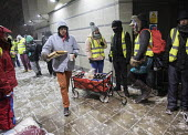 Feed The Homeless charity Bristol, providing hot food, blankets and clothing to homeless on the snow covered streets - Paul Box - 2010s,2018,assisting,charitable,charity,cities,City,cold,distributing,distribution,food,FOODS,freezing,frozen,give,giving,help,helping,HELPS,homeless,homelessness,male,man,men,night time,people,person