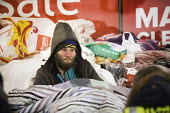 Feed The Homeless charity Bristol, providing hot food, blankets and clothing to homeless on the snow covered streets - Paul Box - 2010s,2018,bed,beds,charitable,charity,cities,City,cold,doorway,food,FOODS,freezing,frozen,giving,help,helping,homeless,homelessness,male,man,men,night time,people,person,persons,precipitation,Rough S