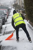 Community snow warden clearing snow from the streets, Bristol - Paul Box - 2010s,2018,cities,City,clear up,clearing,CLIMATE,cold,communities,Community,conditions,freezing,frozen,grit,gritting,hazard,hazardous,HAZARDS,highway,ice,icy,low temperature,male,man,men,pavement,peop