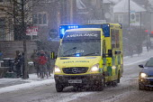 An ambulance on the snow covered streets of Bristol. - Paul Box - 2010s,2018,accident,accidental,accidents,Ambulance,ambulances,AUTO,AUTOMOBILE,AUTOMOBILES,AUTOMOTIVE,car,cars,cities,City,CLIMATE,cold,conditions,DIA,driver,drivers,driving,Emergency Services,employee
