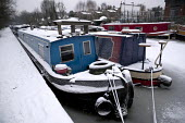 The Regents Canal frozen over, sub zero temperatures due to Storm Emma, East London - Jess Hurd - 2010s,2018,barge,barges,boat,boats,canal,canals,cities,City,CLIMATE,cold,conditions,East London,freezes,freezing,frozen,ice,icy,London,low temperature,moored,moorings,precipitation,Regent's Canal,Seve