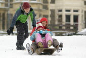 Sledging in St Andrews Park, Bristol - Paul Box - 2010s,2018,age,ageing population,child,CHILDHOOD,children,cities,city,CLIMATE,conditions,elderly,enjoy,enjoying,enjoyment,excited,excitement,exciting,female,females,freezing,frozen,girl,girls,having f