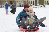 Sledging in St Andrews Park, Bristol - Paul Box - 2010s,2018,age,ageing population,cities,city,CLIMATE,conditions,elderly,enjoy,enjoying,enjoyment,excited,excitement,exciting,FEMALE,freezing,frozen,having fun,hill,hills,ice,icy,Leisure,LFL,LIFE,low t