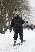 Sledging in St Andrews Park, Bristol - Paul Box - 2010s,2018,boy,boys,child,CHILDHOOD,children,cities,city,CLIMATE,conditions,enjoy,enjoying,enjoyment,freezing,frozen,having fun,hill,hills,ice,icy,juvenile,juveniles,kid,kids,Leisure,LFL,LIFE,low temp