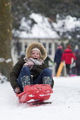 Sledging in St Andrews Park, Bristol - Paul Box - 2010s,2018,boy,boys,child,CHILDHOOD,children,cities,city,CLIMATE,conditions,enjoy,enjoying,enjoyment,excited,excitement,exciting,female,females,freezing,frozen,girl,girls,having fun,hill,hills,ice,icy