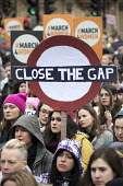 March4Women retracing the historic steps of the suffragettes past Parliament to Trafalgar Square organised by CARE International UK, Westminster, London. Close the Gap for equal pay - Jess Hurd - 2010s,2018,activist,activists,anniversary,CAMPAIGNING,CAMPAIGNS,CARE International UK,DEMONSTRATING,demonstration,Equal Pay,Equal Rights,equality,FEMALE,feminism,feminist,feminists,Gender Equality,his