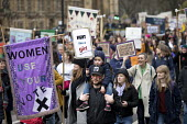 Fight like a girl placard joins March4Women retracing the historic steps of the suffragettes past Parliament to Trafalgar Square organised by CARE International UK, Westminster, London. - Jess Hurd - 04-03-2018