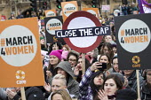 March4Women retracing the historic steps of the suffragettes past Parliament to Trafalgar Square organised by CARE International UK, Westminster, London. Close the Gap for equal pay - Jess Hurd - 2010s,2018,activist,activists,anniversary,CAMPAIGNING,CAMPAIGNS,CARE International UK,DEMONSTRATING,demonstration,Equal Rights,equality,FEMALE,feminism,feminist,feminists,Gender Equality,historic,ineq