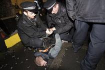 Police arresting Anti fascist protester outside a secret meeting of Jobbik, a far right Hungarian political party, South Kensington, London - Jess Hurd - 2010s,2018,activist,activists,adult,adults,against,anti,Anti fascist,arrest,arrested,arresting,CAMPAIGN,campaigner,campaigners,CAMPAIGNING,CAMPAIGNS,CLJ,DEMONSTRATING,demonstration,DEMONSTRATIONS,far