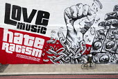 Mural by graffiti artist Snub23 promoting unity, Love Music Hate Racism, Stand up to Racism, Shoreditch, London, prior to the March Against Racism on United Nations Anti Racism Day - Jess Hurd - 2010s,2018,ACE,activist,activists,Against,Anti racism,art,artist,ARTISTS,arts,artwork,artworks,BAME,BAMEs,bicycle,bicycles,BICYCLING,Bicyclist,Bicyclists,bigotry,BIKE,BIKES,Black,Black and White,BME,b
