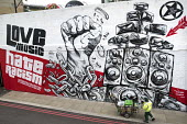 Mural by graffiti artist Snub23 promoting unity, Love Music Hate Racism, Stand up to Racism, Shoreditch, London, prior to the March Against Racism on United Nations Anti Racism Day - Jess Hurd - 2010s,2018,ACE,activist,activists,Against,Anti racism,art,artist,ARTISTS,arts,artwork,artworks,BAME,BAMEs,bigotry,Black,Black and White,BME,bmes,CAMPAIGNING,CAMPAIGNS,cart,carts,cities,City,cleaner,cl