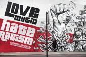 Mural by graffiti artist Snub23 promoting unity, Love Music Hate Racism, Stand up to Racism, Shoreditch, London, prior to the March Against Racism on United Nations Anti Racism Day - Jess Hurd - 2010s,2018,ACE,activist,activists,Against,Anti racism,art,artist,ARTISTS,arts,artwork,artworks,BAME,BAMEs,bigotry,Black,Black and White,BME,bmes,CAMPAIGNING,CAMPAIGNS,cities,City,culture,DEMONSTRATING