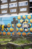 Bee graffiti by Annatomix in a graveyard, Tower Hamlets Cemetry Park, Mile End, East London - Jess Hurd - 2010s,2018,ACE,animal,animals,Annatomix,art,arts,artwork,artworks,Bee,bees,cemeteries,CEMETERY,christian,christianity,CHURCH,churchyard,churchyards,cities,City,cross,crucifix,culture,dead,death,deaths
