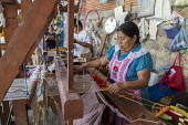 San Miguel del Valle, Oaxaca, Mexico - Mexican woman weaving rugs. Microfinance loans from the non profit En Via are supporting small businesses in the village - Jim West - 24-02-2018