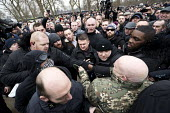 Security guards escorting Tommy Robinson from Speakers Corner. Football Lads Alliance and supporters of Tommy Robinson protest against far right speakers being refused entry to the UK, Hyde Park, Lond... - Jess Hurd - 18-03-2018