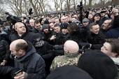Security guards escorting Tommy Robinson from Speakers Corner. Football Lads Alliance and supporters of Tommy Robinson protest against far right speakers being refused entry to the UK, Hyde Park, Lond... - Jess Hurd - 2010s,2018,activist,activists,against,BAME,BAMEs,ban,banned,banning,bigotry,Black,Black and White,Black Kemet group,BME,bmes,campaigner,campaigners,CAMPAIGNING,CAMPAIGNS,DEMONSTRATING,demonstration,Di