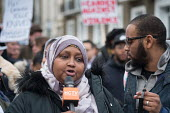 Fowsiya Abdi mother of Sadiq Adaam Mohamed speaking at the site of his fatal stabbing, Kentish Town. Camden Against Violence silent march by community campaigners and NEU against knife crime following... - Philip Wolmuth - 2010s,2018,activist,activists,adult,adults,Against,BAME,BAMEs,black,Black and White,BME,bmes,CAMPAIGNING,CAMPAIGNS,communities,community,crime,demonstratiion,DEMONSTRATING,Demonstration,diversity,ethn
