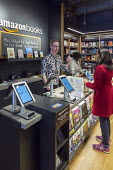 Georgetown, Washington DC Customers buying books at an Amazon bookshop that has replaced a Barnes & Noble bookstore. It displays 5,600 titles that are highly rated on the Amazon.com website - Jim West - 25-03-2018