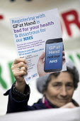 GPs and patients protest against GP at Hand, an online NHS service taking money away from local GP surgeries. Chrisp Street, Poplar, Tower Hamlets, East London - Jess Hurd - 2010s,2018,activist,activists,against,campaign,campaigner,campaigners,campaigning,CAMPAIGNS,Chrisp Street,communicating,communication,DEMONSTRATING,Demonstration,DEMONSTRATIONS,digital,doctor,doctors,