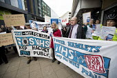 Dr Bennett Richards GP speaking, GPs and patients protest against GP at Hand, an online NHS service taking money away from local GP surgeries. Chrisp Street, Poplar, Tower Hamlets, East London - Jess Hurd - 29-03-2018