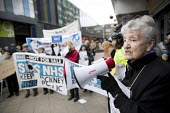 GPs and patients protest against GP at Hand, an online NHS service taking money away from local GP surgeries. Chrisp Street, Poplar, Tower Hamlets, East London - Jess Hurd - 2010s,2018,activist,activists,against,age,ageing population,Anti privatisation,Anti privatisation,anti privatization,campaign,campaigner,campaigners,campaigning,CAMPAIGNS,Chrisp Street,communicating,c
