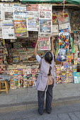Oaxaca, Mexico Newsstand worker adding a newspaper to the display - Jim West - 20-02-2018