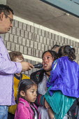 California, USA People of faith and immigrant families hold a protest vigil at The Richmond Detention Center where immigrants are imprisoned before being deported. A woman with her two children asking... - David Bacon - 07-04-2018