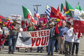 California, USA Migrant farm workers and their supporters march in protest at immigration raids. Organized by the UFW union, also celebrating the birthday of union founder Cesar Chavez. UFW President... - David Bacon - united farm workers,2010s,2018,activist,activists,AFL CIO,AFL-CIO,Arturo Rodriguez,BAME,BAMEs,banner,banners,BME,bmes,California,CAMPAIGNING,CAMPAIGNS,CELEBRATE,celebrating,child,CHILDHOOD,children,DE