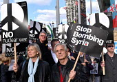 Stop The War Coalition Don't Bomb Syria rally, Parliament Square, London. Protest against airstrikes by UK, French and American forces - Stefano Cagnoni - peace movement,2010s,2018,activist,activists,against,anti war,atomic,Bomb,bombing,bombings,bombs,Campaign for nuclear disarmament,CAMPAIGNING,CAMPAIGNS,CND,CND Symbol,Coalition,DEMONSTRATING,Demonstra