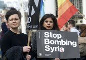 Stop The War Coalition Don't Bomb Syria rally, Parliament Square, London. Protest against airstrikes by UK, French and American forces - Stefano Cagnoni - 2010s,2018,activist,activists,against,anti war,atomic,Bomb,bombing,bombings,bombs,Campaign for Nuclear Disarmament,CAMPAIGNING,CAMPAIGNS,CND,Coalition,DEMONSTRATING,Demonstration,DEMONSTRATIONS,female