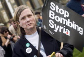 Stop The War Coalition Don't Bomb Syria rally, Parliament Square, London. Protest against airstrikes by UK, French and American forces - Stefano Cagnoni - 2010s,2018,activist,activists,against,anti war,Bomb,bombing,bombings,bombs,CAMPAIGNING,CAMPAIGNS,Coalition,DEMONSTRATING,Demonstration,DEMONSTRATIONS,female,foreign policy,Parliament,people,person,per