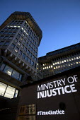 Vigil for Justice defending legal aid, organised by the Justice Alliance outside the Ministry of Justice, London Ministry of Injusticee projected onto the building - Jess Hurd - 18-04-2018