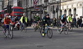 Commuters cycling home from work, evening rush hour, Westminster London - Stefano Cagnoni - 2010s,2018,adult,adults,bicycle,bicycles,bicycles. cycle helmets,BICYCLING,Bicyclist,Bicyclists,BIKE,BIKES,bus,bus service,BUSES,busy,cities,City,COMMUTE,commuter,commuters,commuting,cycle,cycle. cycl