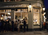 Workers enjoying a drink after work on a warm early Spring evening at The Old Star pub Westminster London - Stefano Cagnoni - 2010s,2018,adult,adults,alcohol,bar,BARS,beer,cities,City,communicating,communication,COMMUTE,commuter,commuters,commuting,conversation,conversations,customer,customers,dialogue,discourse,discuss,disc