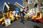 Giant chlorinated chickens opposing a US trade deal visiting Somerset constituency surgery of Liam Fox MP, protest organised by Global Justice Now over the concern that hormone treated, chlorine washe... - Jess Hurd - 2010s,2018,activist,activists,american,americans,British,CAMPAIGN,campaigner,campaigners,CAMPAIGNING,CAMPAIGNS,chicken,chickens,chlorinated,chlorination,chlorine,constituency,costume,costumes,deal,DEM