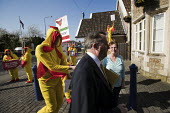 Giant chlorinated chickens opposing a US trade deal visiting Somerset constituency surgery of Liam Fox MP, protest organised by Global Justice Now over the concern that hormone treated, chlorine washe... - Jess Hurd - 2010s,2018,activist,activists,american,americans,British,CAMPAIGN,campaigner,campaigners,CAMPAIGNING,CAMPAIGNS,chicken,chickens,chlorinated,chlorination,chlorine,CONSERVATIVE,Conservative Party,conser