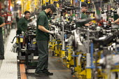 Jaguar Land Rover factory, Solihull. Workers assembling final drive - John Harris - 2010s,2017,assembling,assembly,AUTO,AUTOMOBILE,AUTOMOBILES,automotive,car,Car Industry,carindustry,cars,EBF,Economic,Economy,employee,employees,Employment,engineer,engineers,FACTORIES,factory,Jaguar,J