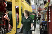 Jaguar Land Rover factory, Solihull. Woman assembly worker - John Harris - 2010s,2017,assembly,AUTO,AUTOMOBILE,AUTOMOBILES,automotive,car,Car Industry,carindustry,cars,EBF,Economic,Economy,employee,employees,Employment,engineer,engineers,FACTORIES,factory,FEMALE,Jaguar,Jagua
