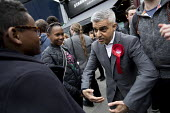 Sadiq Khan talking rugby with a young supporter, Labour Party local election campaign, Earlsfield ward, Wandsworth, London - Jess Hurd - 2010s,2018,BAME,BAMEs,Black,BME,bmes,campaign,campaigning,CAMPAIGNS,candidate,candidates,CANVASING,canvassing,cities,City,communicating,communication,conversation,conversations,DEMOCRACY,dialogue,disc