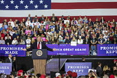 Washington Township, Michigan USA: President Donald Trump campaign rally - Jim West - 2010s,2018,America,american,americans,campaign,CAMPAIGNING,CAMPAIGNS,Donald Trump,Far Right,Far Right,Flag,flags,government,horizontal,Macomb County,Michigan,nationalism,nationalist,nationalists,POL,p