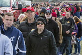 Washington Township, Michigan USA - 28 April 2018 - People wait in a long line for security clearance before a Donald Trump campaign rally in Macomb County, Michigan. Trump skipped the annual White Ho... - Jim West - 2010s,2018,America,american,americans,campaign,CAMPAIGNING,CAMPAIGNS,dinner,dinners,Donald Trump,Far Right,Far Right,government,horizontal,House,houses,journey,journeys,line,Macomb County,male,man,men