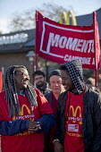 McDonalds workers strike for £10 per hour, an end to zero hours contracts and union recognition on International Workers Day, Cambridge - Jess Hurd - 2010s,2018,£10 per hour,ACTIVIST,ACTIVISTS,against,BAME,BAMEs,banner,banners,BFAWU,Black,Black and White,BME,bmes,Cambridge,campaign,campaigner,campaigners,campaigning,CAMPAIGNS,catering,contract,con