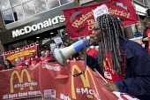 McDonalds workers strike for £10 per hour, an end to zero hours contracts and union recognition on International Workers Day, Watford, home to global CEO Steve Easterbrook - Jess Hurd - 2010s,2018,£10 per hour,ACTIVIST,ACTIVISTS,against,BAME,BAMEs,banner,banners,BFAWU,Black,Black and White,BME,bmes,campaign,campaigner,campaigners,campaigning,CAMPAIGNS,catering,contract,contracts,DEM