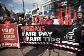 TGI Fridays Fair Tips campaigners supporting McDonalds workers strike for £10 per hour, an end to zero hours contracts and union recognition on International Workers Day, Watford, home to global CEO... - Jess Hurd - 2010s,2018,£10 per hour,ACTIVIST,ACTIVISTS,against,banner,banners,BFAWU,campaign,campaigner,campaigners,campaigning,CAMPAIGNS,catering,contract,contracts,DEMONSTRATING,demonstration,DEMONSTRATIONS,di