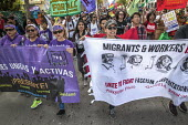 California, USA: Community and immigrant rights organizations march through Oakland to celebrating May Day - David Bacon - 2010s,2018,activist,activists,Asian,BAME,BAMEs,banner,banners,BME,bmes,California,campaigner,campaigners,CAMPAIGNING,CAMPAIGNS,CELEBRATE,celebrating,CHILD,CHILDHOOD,children,communities,community,DEMO