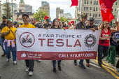 California, USA: Tesla UAW workers with community, immigrant rights organizations march through Oakland to celebrating May Day - David Bacon - 01-05-2018