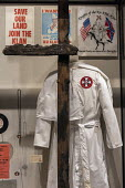 Jackson, Mississippi, USA: The Mississippi Civil Rights Museum. A Ku Klux Klan robe and burned cross. History of the American Civil Rights Movement in the state of Mississippi between 1945 and 1970 - Jim West - 2010s,2018,ACE,African American,America,american,americans,bigotry,black,burned cross,case,civil rights,civil rights movement,civil rights museum,costume,costumes,cross,cross burning,Culture,discrimin