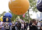 TUC New Deal For Working People demonstration London 2018. CSP trade union members on the demonstration - Stefano Cagnoni - 2010s,2018,activist,activists,Austerity Cuts,balloon,balloons,banner,banners,campaign,campaigning,CAMPAIGNS,CSP,DEMONSTRATING,demonstration,London,march,member,member members,members,New Deal For Work